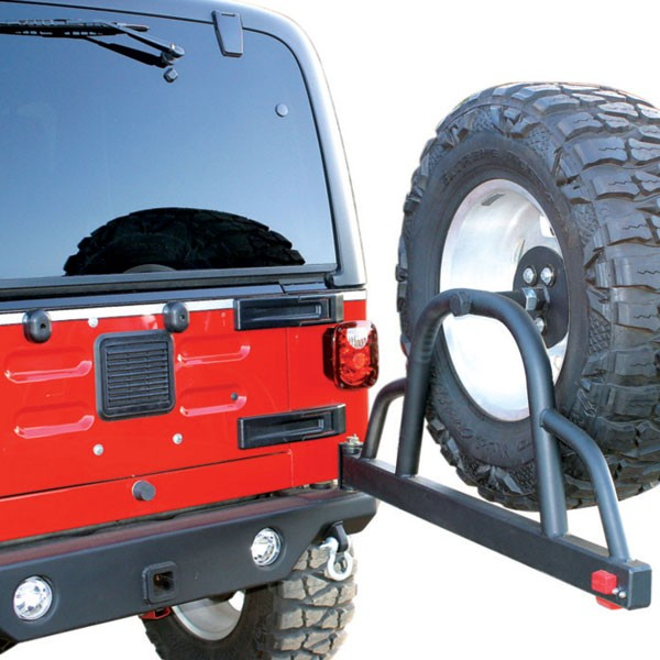 jeep knowledge center cj series spare tire carrier solutions rh morris4x4center com Swing Out Tire Carrier Kit Jeep CJ7 Spare Tire Swing