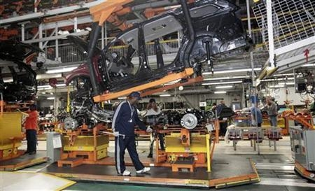 Chrysler auto assembly workers work on the line assembling Jeep Grand Cherokees and Dodge Durangos at the Chrysler Jefferson North Assembly plant in Detroit